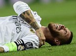 Real Madrid's defender Sergio Ramos complains on the ground during the UEFA Champions League group A football match Real Madrid CF vs FC Shakhtar Donetsk at the Santiago Bernabeu stadium in Madrid on September 15, 2015. AFP PHOTO/ JAVIER SORIANOJAVIER SORIANO/AFP/Getty Images