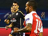 Theo Walcott of Arsenal scores a goal to make the score 2-1 during the UEFA Champions League Group F match between GSK Dinamo Zagreb and Arsenal played at The Stadion Maksimir, Zagreb