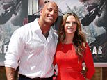 HOLLYWOOD, CA - MAY 19: Dwayne 'The Rock' Johnson and girlfriend, Lauren Hashian attend the hand/footprint ceremony honoring him held at TCL Chinese Theatre IMAX on May 19, 2015 in Hollywood, California.  (Photo by JB Lacroix/WireImage)
