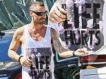 """UK CLIENTS MUST CREDIT: AKM-GSI ONLY\nEXCLUSIVE: *SHOT ON 9/14/15* Brentwood, CA - Brian Austin Green buys groceries at his local Whole Foods Market late Monday afternoon and still wearing his wedding ring on his finger with a t-shirt that read """"Life Hurts"""", maybe describing his current relationship with Megan Fox.\n\nPictured: Brian Austin Green\nRef: SPL1127888  150915   EXCLUSIVE\nPicture by: AKM-GSI / Splash News\n\n"""