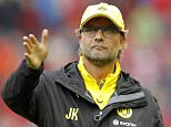 File photo dated 10-08-2014 of Borussia Dortmund manager Jurgen Klopp applauds the fans after the match PRESS ASSOCIATION Photo. Issue date: Friday April 17, 2015. Arsenal defender Per Mertesacker has tipped compatriot Jurgen Klopp to make his mark in the Barclays Premier League if he opts to continue his career in England. See PA story SOCCER Klopp. Photo credit should read Richard Sellers/PA Wire.