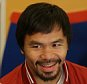 Filipino boxer Manny Pacquiao smiles during an interview in suburban Pasay, south of Manila, Philippines, Wednesday, Sept. 16, 2015. Pacquiao said boxing is not his main focus these days and a rematch with Floyd Mayweather may not happen because the American champion said he was retiring. (AP Photo/Aaron Favila)