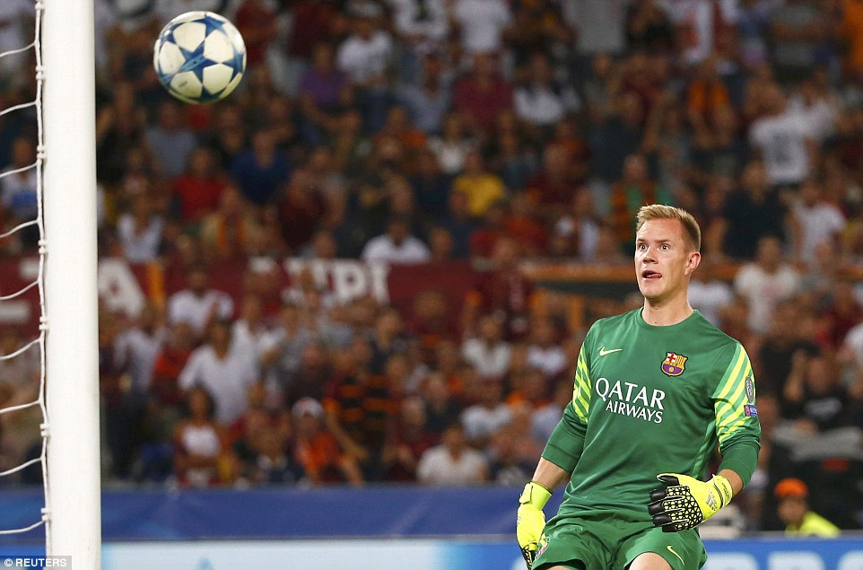Germany international Ter Stegen looks at the ball as it flies over him and lands in the back of his net at the Stadio Olimpico