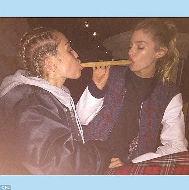 Yes they did: The Last Song actress sharing a Churro with Maxwell in an outrageous post from July