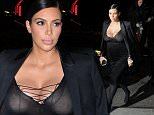 Mandatory Credit: Photo by Buzz Foto/REX Shutterstock (5083840b)\n Kim Kardashian\n Kim Kardashian and Kourtney Kardashian out and about, New York, America - 15 Sep 2015\n Kim and Kourtney Kardashian seen entering The Polo Bar for dinner, New York City\n