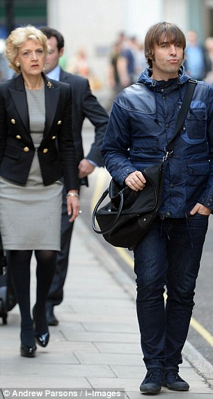 High profile: Liam Gallagher with top divorce lawyer Fiona Shackleton