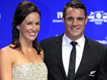 Dan Carter, right, of the New Zealand's All Blacks rugby team, and his wife Honor Carter pose for photos upon arriving at the Laureus World Sports Awards in Kuala Lumpur, Malaysia, Wednesday, March 26, 2014. (AP Photo/Lai Seng Sin)