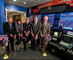 Photo of Senior executives from NSA and the National Cryptologic Museum Foundation cut the ribbon for the museum's newest exhibit.