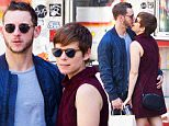 September 16, 2015: Kate Mara and boyfriend Jamie Bell can't keep their hands off of each other as they display PDA as they grab coffee from La Colombe and take a walk  around New York City.\nMandatory Credit: Alberto Reyes/INFphoto.com Ref: infusny-261