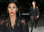 Kim Kardashian and Kourtney Kardashian wear sheer/lacy outfits in NYC\n\nPictured: Kim Kardashian, Kourtney Kardashian\nRef: SPL1127663  150915  \nPicture by: XactpiX/Splash\n\nSplash News and Pictures\nLos Angeles: 310-821-2666\nNew York: 212-619-2666\nLondon: 870-934-2666\nphotodesk@splashnews.com\n