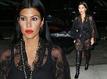 Kim Kardashian and Kourtney Kardashian wear sheer/lacy outfits in NYC\n\nPictured: Kim Kardashian, Kourtney Kardashian\nRef: SPL1127663  150915  \nPicture by: XactpiX/Splash\n\nSplash News and Pictures\nLos Angeles: 310-821-2666\nNew York: 212-619-2666\nLondon: 870-934-2666\nphotodesk@splashnews.com\n