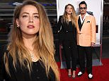 """BROOKLINE, MA - SEPTEMBER 15:  Actors Amber Heard and Johnny Depp attend the Boston premiere of """"Black Mass"""" at Coolidge Corner Theater on September 15, 2015 in Brookline, Massachusetts.  (Photo by Mike Lawrie/WireImage)"""