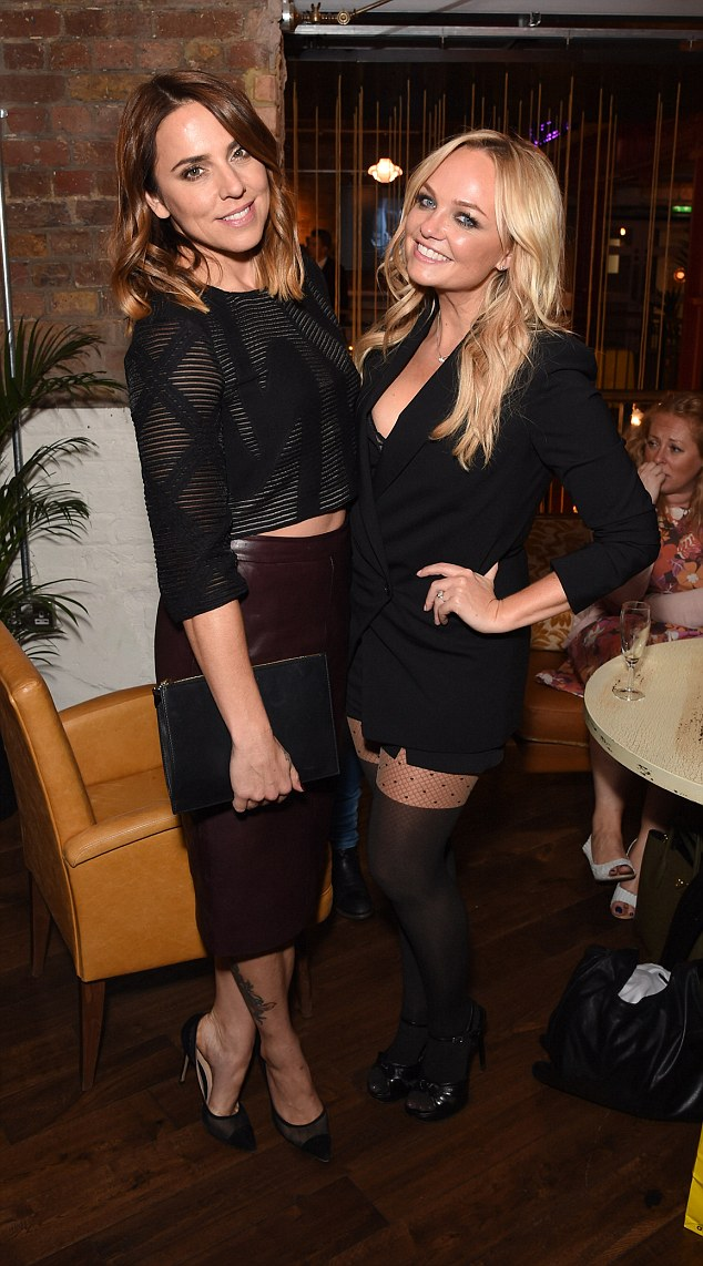 Differing styles? Dressed slightly more reserved than Emma in her costume, Mel, 41, still looked chic as she teamed a semi-sheer black top with a burgundy leather pencil skirt and heels