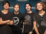 NEW YORK, NY - AUGUST 21:  (EXCLUSIVE COVERAGE) Calum Hood, Luke Hemmings, Michael Clifford and Ashton Irwin of 5 Seconds of Summer visit at SiriusXM Studios on August 21, 2015 in New York City.  (Photo by Robin Marchant/Getty Images)