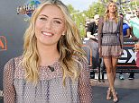"UNIVERSAL CITY, CA - SEPTEMBER 16:  Maria Sharapova visits ""Extra"" at Universal Studios Hollywood on September 16, 2015 in Universal City, California.  (Photo by Noel Vasquez/Getty Images)"