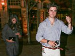 UK CLIENTS MUST CREDIT: AKM-GSI ONLY EXCLUSIVE: **SHOT ON 9/15/15** Calabasas, CA - It looks like Selena Gomez is done with bad boys, as she was seen enjoying a romantic date night with old fling and co-star David Henrie.  David was wearing a cross on a necklace around his neck as the couple exited Tosconova restaurant in Calabasas.  The two appeared to be catching up and were seen drinking wine while they enjoyed each others company.  Are Selena and David rekindling a old romance?  Pictured: Selena Gomez, David Henrie Ref: SPL1129666  170915   EXCLUSIVE Picture by: AKM-GSI / Splash News