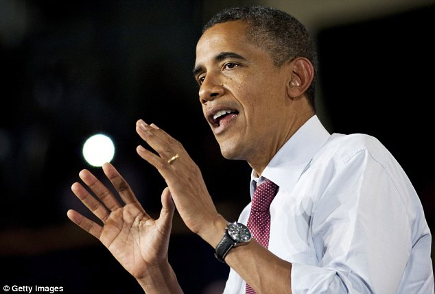 Counter-attack: Mr Obama is accusing Mr Romney of trying to reduce his own tax rate