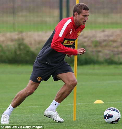 Coming back: Nemanja Vidic in training last month