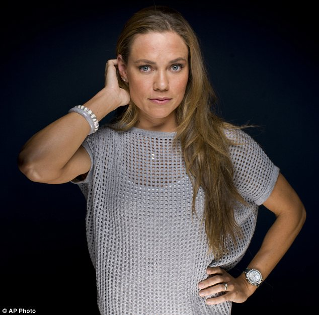 Natural beauty: Olympic medalist Natalie Coughlin has developed a strict beauty regime to ensure she appears camera-ready once she jumps out of the pool. It involves no make-up but plenty of healthy eating and even leave-in conditioner