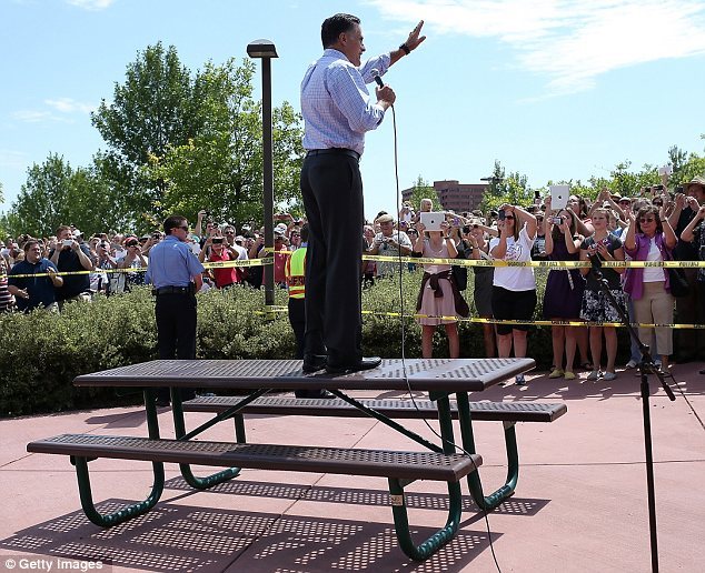 Crowd: The GOP candidate climbed on a table to address a throng of supporters at a fairground