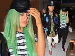 Kylie Jenner and boyfriend Tyga seen at Los Angeles airport arriving back from NY.    Pictured: Kylie Jenner and Tyga Ref: SPL1129089  170915   Picture by: Splash News  Splash News and Pictures Los Angeles: 310-821-2666 New York: 212-619-2666 London: 870-934-2666 photodesk@splashnews.com