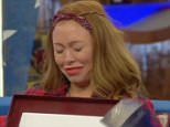 ****Ruckas Videograbs****  (01322) 861777 *IMPORTANT* Please credit Channel 5 for this picture. 17/09/15 Celebrity Big Brother  Day 22 SEEN HERE: As part of the Box of Secrets shopping task, Natasha Hamilton is given a selection of photographs from home last night Grabs from inisde the CBB house overnight **IMPORTANT - PLEASE READ** The video grabs supplied by Ruckas Pictures always remain the copyright of the programme makers, we provide a service to purely capture and supply the images to the client, securing the copyright of the images will always remain the responsibility of the publisher at all times. Standard terms, conditions & minimum fees apply to our videograbs unless varied by agreement prior to publication.