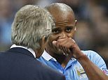 Football - Manchester City v Juventus - UEFA Champions League Group Stage - Group D - Etihad Stadium, Manchester, England - 15/9/15  Manchester City's Vincent Kompany with manager Manuel Pellegrini after being substituted  Action Images via Reuters / Carl Recine  Livepic  EDITORIAL USE ONLY.