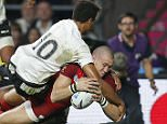 England's Mike Brown forces his way over to score a try during the Rugby World Cup Pool A match between England and Fiji at Twickeham stadium in London, Friday, Sept. 18, 2015. (AP Photo/Christophe Ena)