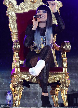 Hands up if you're having fun: The star soldiered on with her injury sitting on her throne, just like she had at the Summertime Ball in London earlier this month, right
