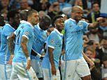 epa04932271 Manchester City's Vincent Kompany (R) celebrates with teammates the 1-0 goal  during the UEFA Champions League group D soccer match between Manchester City and Juventus held at the Etihad Stadium in Manchester, Britain, 15 September 2015.  EPA/PETER POWELL