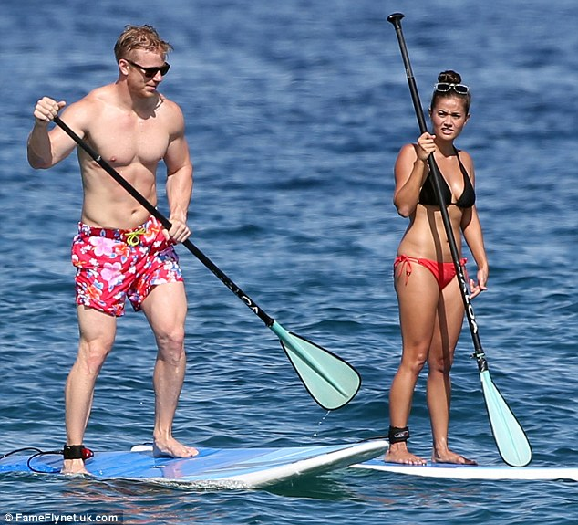 Beach babes: Sean and Catherine Lowe were seen treating themselves to a little romantic getaway in tropical Hawaii on Friday