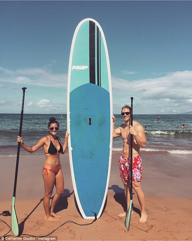 "On island time: Posting a snap shot of them with their board on her Instagram, Catherine wrote, 'Paddle boarding, just as our ancestors did. (Sean thinks he's an islander and won't stop calling people ""brudda"")'"
