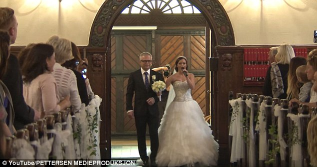 Maria Holand Tøsse and her father, Charles, serenaded her husband-to-be, Ronny Eidsvik, at the couple's wedding ceremony inNorway's Ålesund Church on August 8