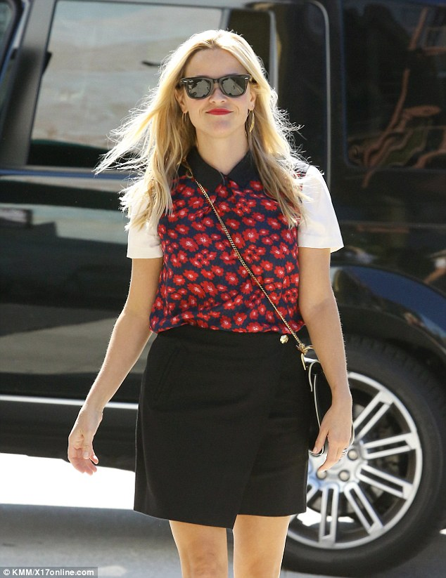 Confident: The Legally Blonde star walked with an air of confidence as her long locks blew gently in the breeze
