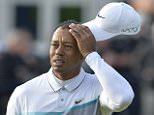 USA's Tiger Woods looks dejected on the 18th during day three of The Open Championship 2015 at St Andrews, Fife. PRESS ASSOCIATION Photo. Picture date: Saturday July 19, 2015. See PA story GOLF Open. Photo credit should read: Owen Humphreys/PA Wire. RESTRICTIONS: Editorial use only - no commercial use. No onward sale. Still image use only. The Open Championship logo and clear link to The Open website (www.TheOpen.com) to be included on website publishing. Call +44 (0)1158 447447 for further info.