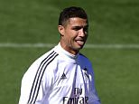 Real Madrid's Portuguese forward Cristiano Ronaldo sticks out his tongue during a training session at Valdebebas Sport City in Madrid on September 18, 2015. AFP PHOTO/ PIERRE-PHILIPPE MARCOUPIERRE PHILIPPE MARCOU,PIERRE-PHILIPPE MARCOU/AFP/Getty Images
