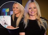 """Actress Pamela Anderson pauses while speaking during the launch of her book """"Raw"""" in Vancouver, British Columbia, on Friday Sept. 18, 2015.  (Darryl Dyck/The Canadian Press via AP)"""