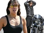 Malibu, CA - Actress, Michelle Rodriguez, oozed sex appeal as she was spotted leaving Tra Di Noi restaurant in full biker gear.  She was seen showing off her beautiful bike to some friends before she hoped on and rode off to PCH.\nAKM-GSI       September 18, 2015\nTo License These Photos, Please Contact :\nSteve Ginsburg\n(310) 505-8447\n(323) 423-9397\nsteve@akmgsi.com\nsales@akmgsi.com\nor\nMaria Buda\n(917) 242-1505\nmbuda@akmgsi.com\nginsburgspalyinc@gmail.com