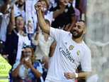Real Madrid's French forward Karim Benzema celebrates after scoring a goal during the Spanish league football match Real Madrid CF vs Granada FC at the Santiago Bernabeu stadium in Madrid on Spetember 19, 2015.   AFP PHOTO/ JAVIER SORIANOJAVIER SORIANO/AFP/Getty Images