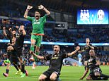 TOPSHOTS Juventus' goalkeeper from Italy Gianluigi Buffon (C) celebrates with teammates after wining a UEFA Champions League group stage football match between Manchester City and Juventus at the Etihad stadium in Manchester, north-west England on September 15, 2015.    AFP PHOTO / OLI SCARFFOLI SCARFF/AFP/Getty Images