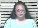 Rowan County Kentucky Clerk Kim Davis in a booking photo after being put in jail for contempt of court for refusing several court orders to start issuing marriage licenses in Rowan County, Kentucky, USA, 03 September 2015.   The US Supreme Court ruled in June 2015 that gay couples had a constitutional right in the US to get married.   A Carter County Detention Center handout image released 03 September 2015.   EPA/CARTER COUNTY DETENTION CENTER /  HANDOUT EDITORIAL USE ONLY/NO SALES. epa04911995
