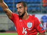 England's forward Theo Walcott celebrates after scoring during the EURO 2016 qualifying football match San Marino vs England at the San Marino stadium in Serravalle on September 5, 2015.  AFP PHOTO / VINCENZO PINTOVINCENZO PINTO/AFP/Getty Images