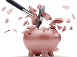Broken Piggy Bank with hammer; Shutterstock ID 120556300