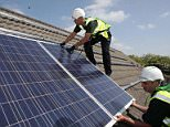 Workmen installing solar panels on to the roofs of homes in Delabole near Bodmin as the Government is set to announce plans to reduce subsidies for household solar electricity this week, with fears that the payments could be slashed by half.   PRESS ASSOCIATION Photo. Issue date: Sunday October 30, 2011. See PA story ENVIRONMENT Solar. Photo credit should read: Simon Burt/PA Wire.  File photo dated 27/04/2011.