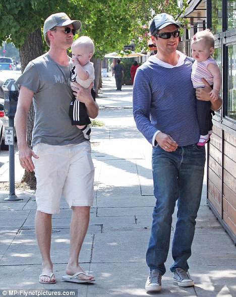 Family unit: The How I Met Your Mother star and his partner have been together for seven years and welcomed twins born by a surrogate last year