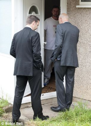 Officer in charge of the case, DCI Nick Scola (R) arriving at Tia Sharp's Grandmother's house in New Addington