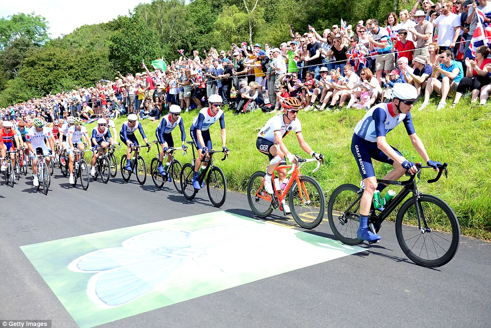 On the charge: Cavendish (sixth from left) is supported by fellow Team GB riders Chris Froome (right), Tony Martin, Bradley Wiggins, David Millar and Ian Stannard