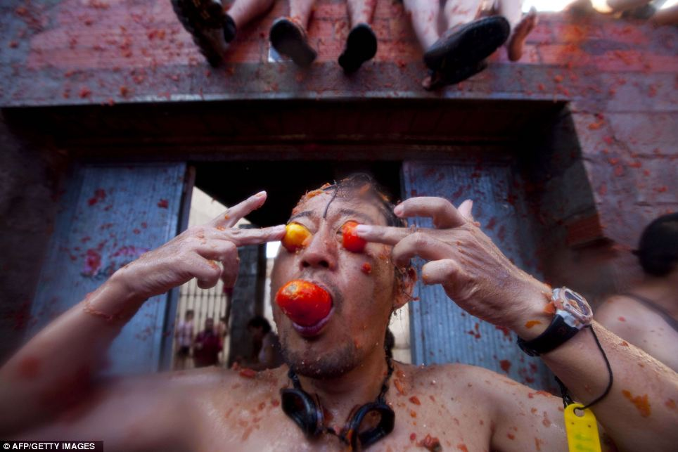 Party people: This man has found another use for tomatoes besides throwing them at the Spanish festival