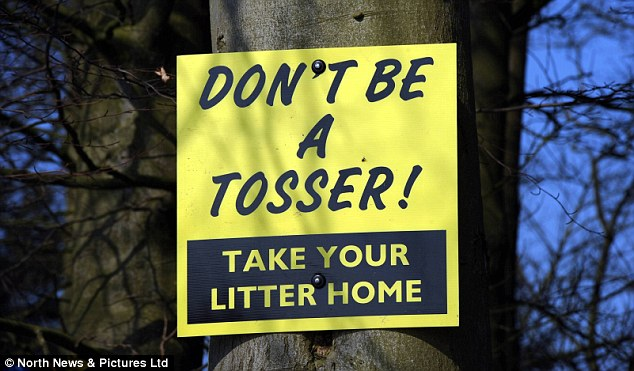 Garish: Mrs Riddell's signs have been causing offence in some quarters due to the use of the word 'tosser' and their 'ghastly' yellow colour