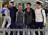 Osama Abdul Mohsen (center), poses with his sons and two welcomers at Atocha train station in Madrid, September 17, 2015. (AFP/File)